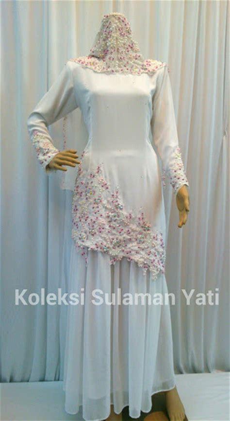 tempahan baju nikah putih lace dgn gabungan manik ungu dan pink