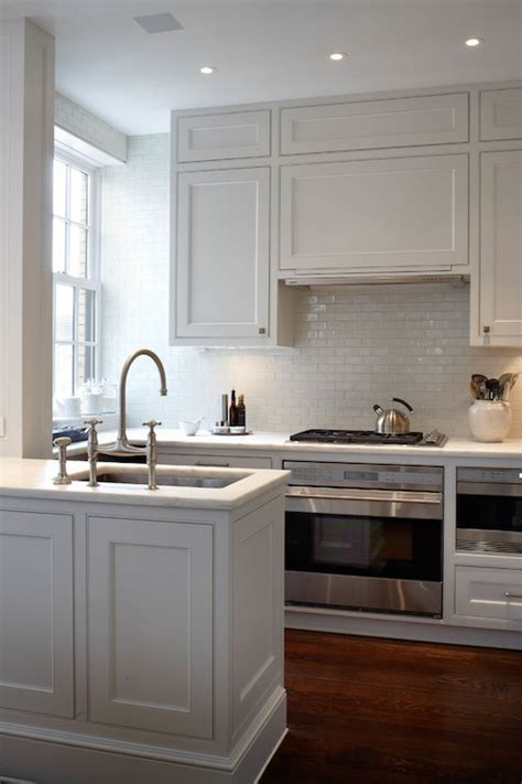 peninsula sink white glazed mini subway tiles small kitchen ideas