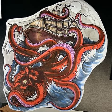 red furious octopus crashing a pirate ship tattoo design