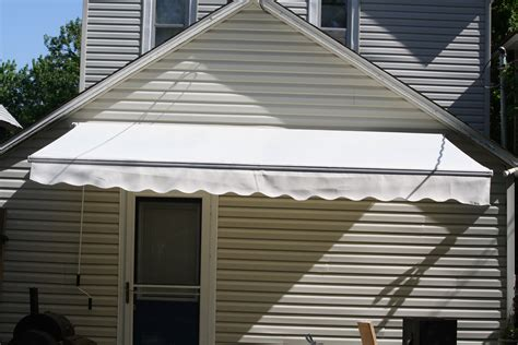 stay cool and cut energy costs with a retractable awning