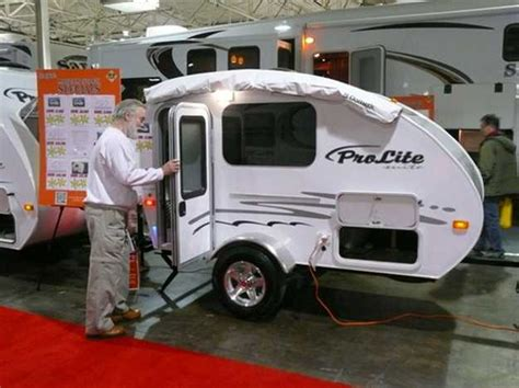 very small travel trailer for one small car towing