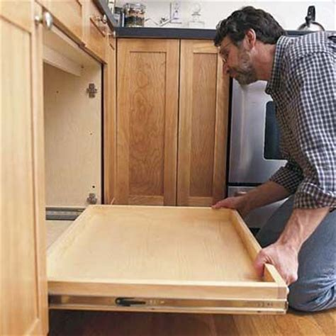 How To Build Pull Out Shelves For Kitchen Cabinets How To Install A Pull Out Kitchen Shelf Sliding Shelves Sink And Cabinets