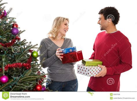 christmas couple giving gifts royalty free stock photo