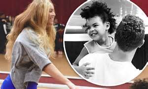 martin blue ivy beyonce posts snaps of blue ivy and chris martin before