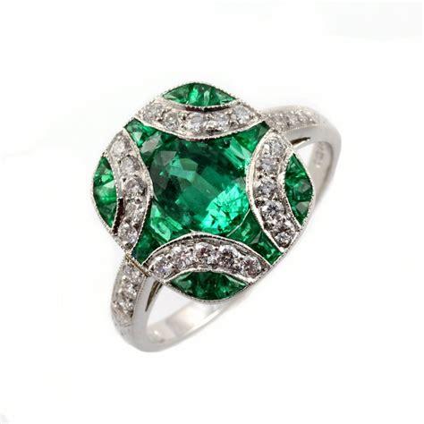 Platinum emerald & diamond cross design ring.   from Mr