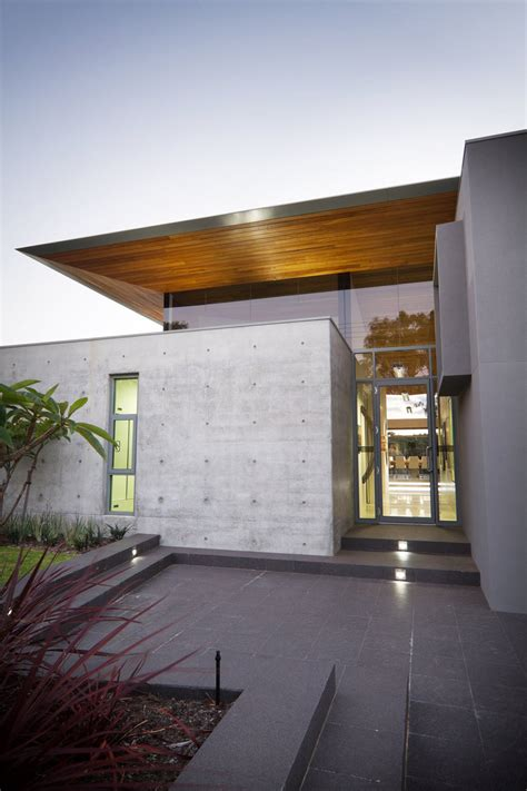 glass front house glass front door concrete wall the 24 house in