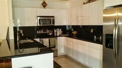 kitchen cabinets hialeah fl transitional kitchen in hialeah black quartz countertop