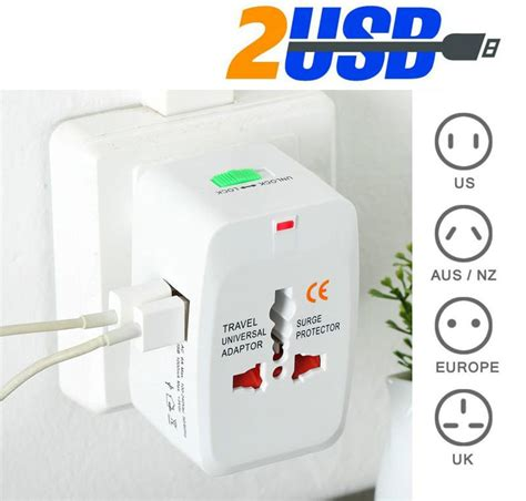 Travel Adapter Universal Eu Uk Us Dengan 1a Usb Port universal travel adapter eu au uk us with 2 usb port white jakartanotebook