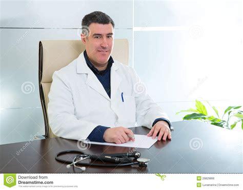 Man Sitting At A Desk Doctor Man Sitting In Hospital Office Desk Portrait