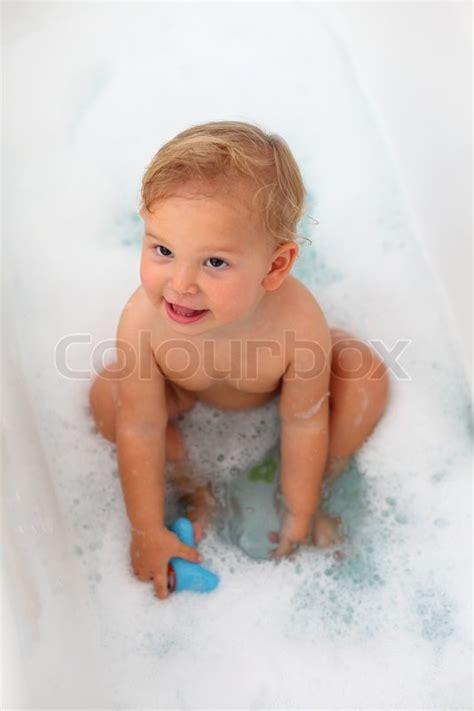 toddler girl in the bath tub stock photo colourbox