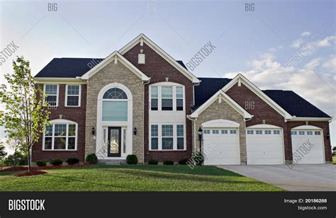 how big is a 3 car garage three car garage luxury home image photo bigstock