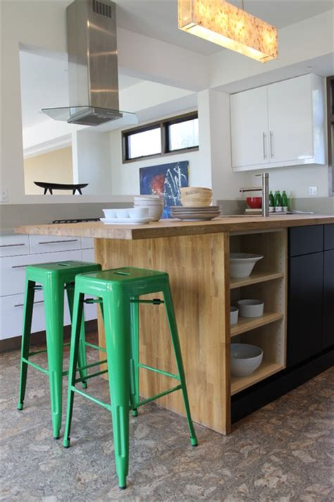 green tolix bar stools and butcher block island