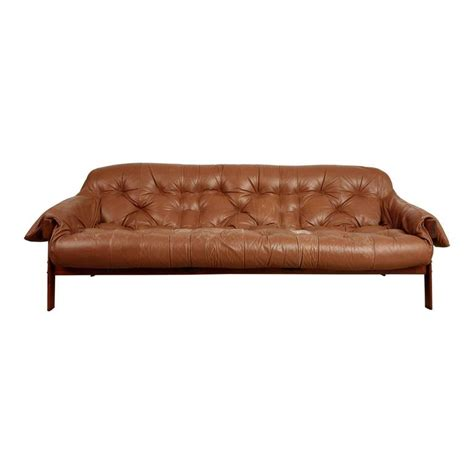 percival lafer rosewood and distressed leather tufted sofa