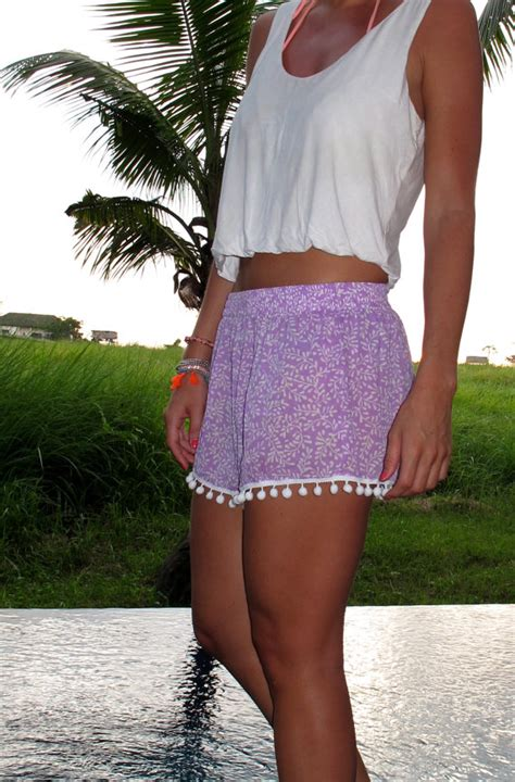 white patterned shorts pom pom shorts lilac and white leaf vine pattern with