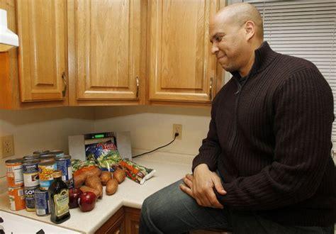 battle   budget cory booker begins weeklong food