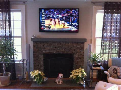 55 Inch Tv Above Fireplace installs flatscreens on wall