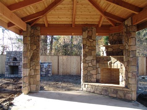 covered patio with fireplace outdoor fireplace outdoor living column stone veneer