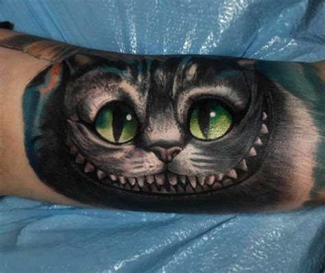 chesire cat tattoo realistic chesire cat on the left inner arm