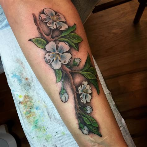 apple blossom tattoo by nic lebrun tattoos