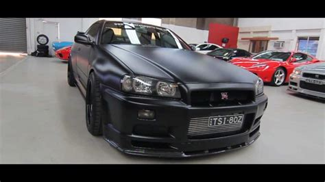 nissan r34 black 1999 r34 gtr v spec matte black 500kw top secret imports