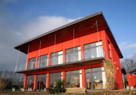 glazed face modern house design in red colors archinspire