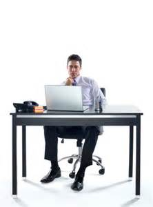 businessman sitting at computer desk stock photo getty