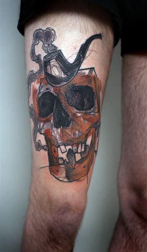 by peter aurisch tattoo peter aurisch tattoo skull pipe tattoomagz