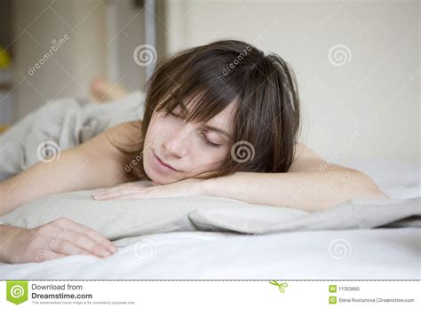 lying on the bed serious sad woman lying on bed royalty free stock photo
