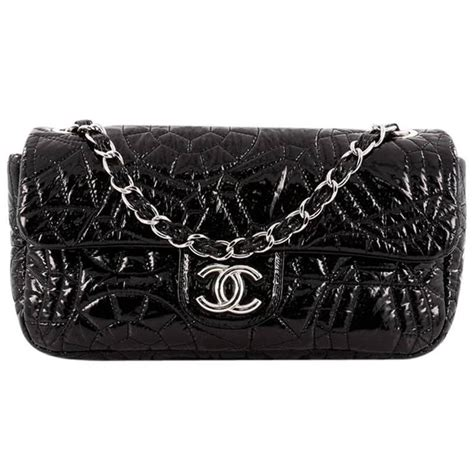 Preowned Authentic Chanel Silver Patent Vinyl Camellia Flap Bag chanel graphic edge flap bag quilted patent vinyl medium