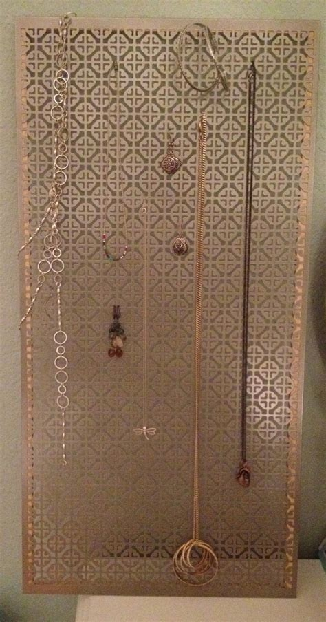 jewelry holder made from decorative metal sheet from home