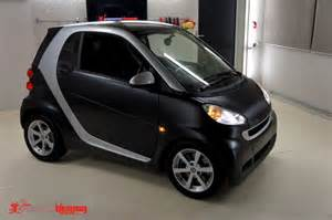 matte black smart fortwo car vinyl wrap by carbon