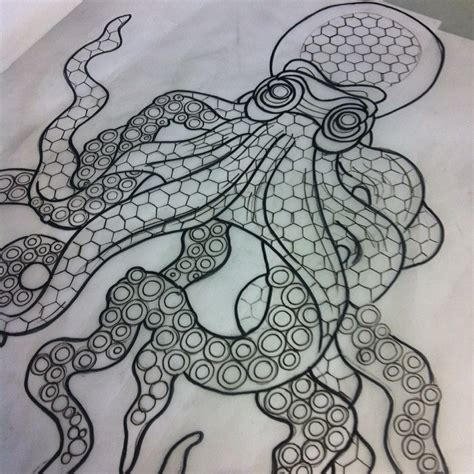 interesting grey geometric patterned octopus tattoo design