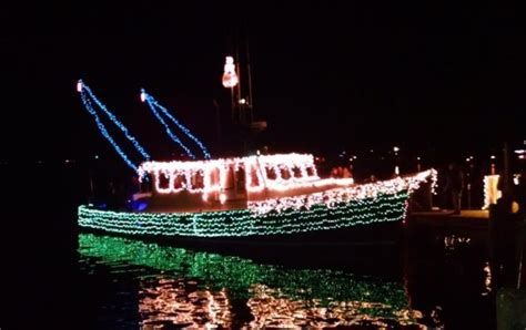 river street boat parade see trees in the rigging community carol sing boat