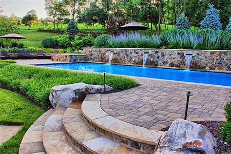 Front Yard Walkways - swimming pool with fountains spa and open air pool house surrounds landscape architecture