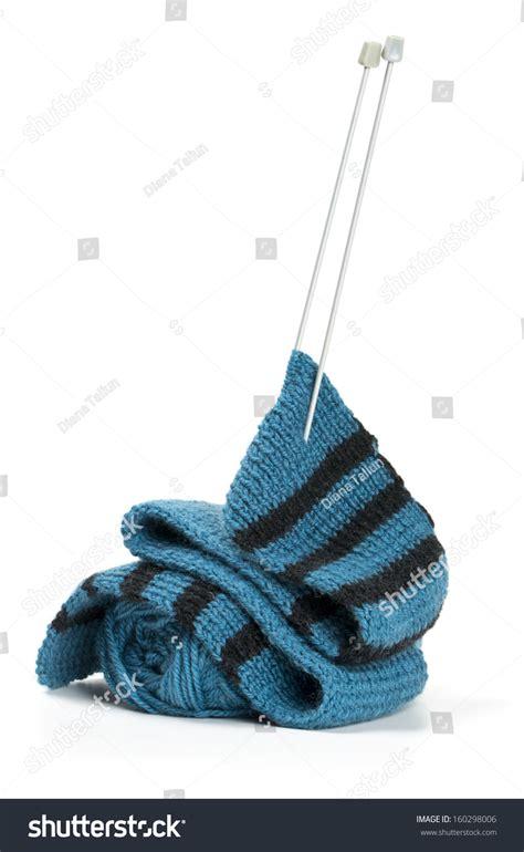 knitting needles for scarves striped scarf on knitting needles white stock photo