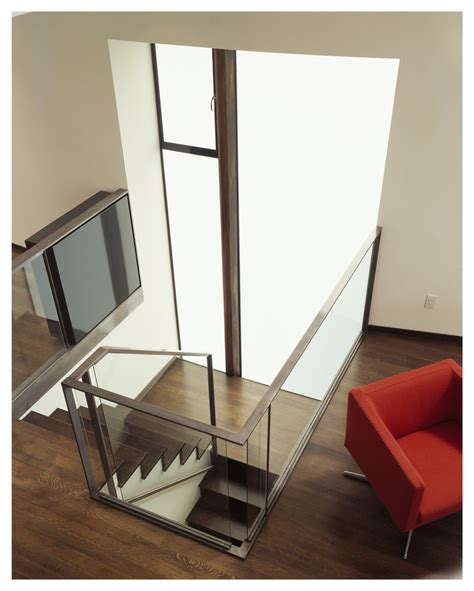 glass staircase banister banister staircase transitional with open floor plan metal