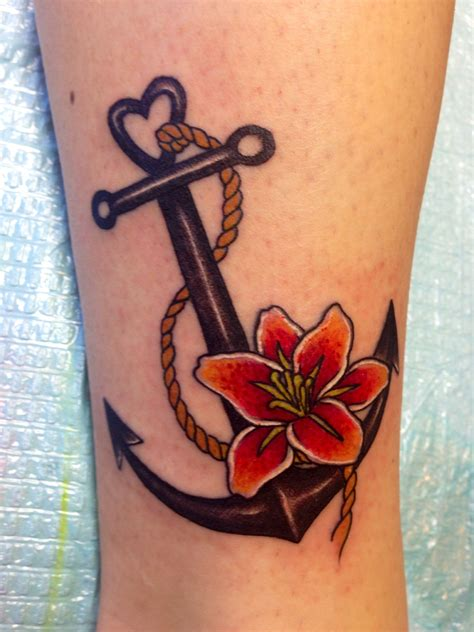 navy anchor tattoo dont like the flower or rope but its a place to