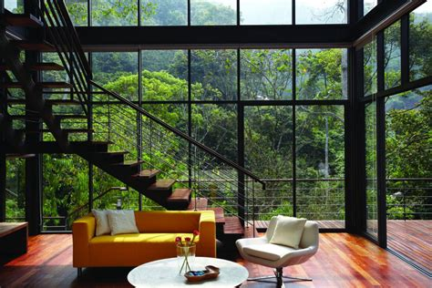 house windows design malaysia stairs yellow sofa living space glass walls modern