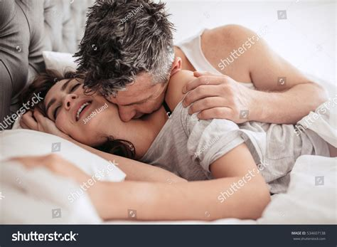 boy girl kissing bedroom online image photo editor shutterstock editor