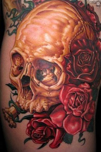 rose golds tattoo gold skull with roses