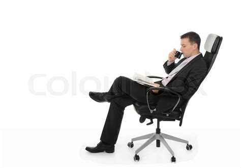 Sit In A Chair Or Sit On A Chair by Businessman Talking On The Phone Sitting In A Chair In A