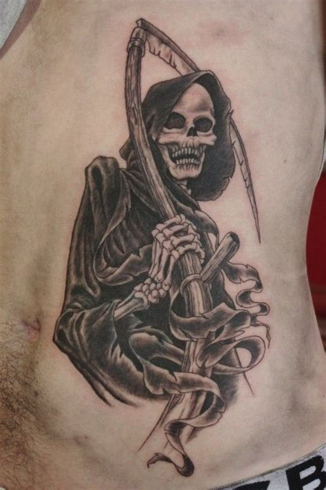 scythe tattoo black and gray with scythe on ribs