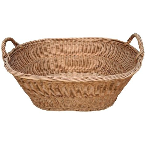 vintage french provincial wicker woven laundry basket at
