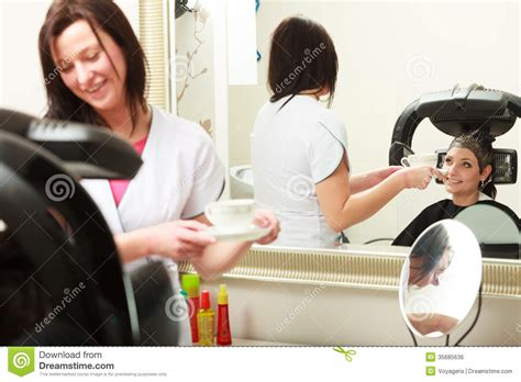 hairdresser giving coffee tea client hairdressing