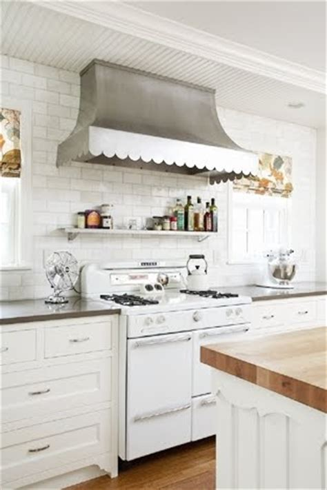 small white kitchen with steel hood hood taste in the kitchen wall mount stainless range