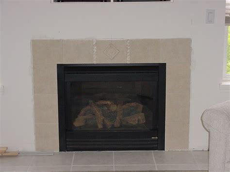 tiling around a fireplace 302 found