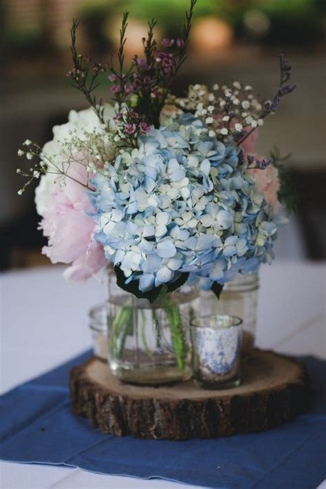 reception venue table centerpiece decoration flowers blue
