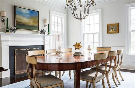 dining table in front of fireplace gold french dining chairs with blue damask seat cushions