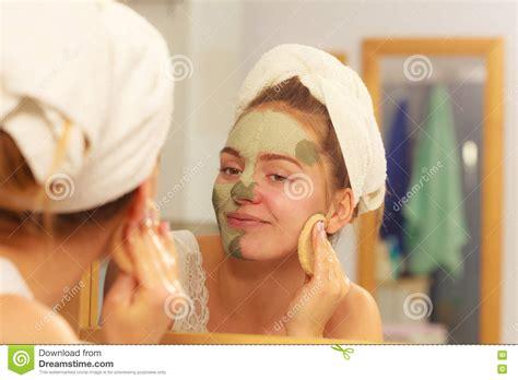 bathroom facials bathroom facials woman removing facial clay mud mask in
