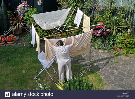 Garden Clothes Line Hanging Out Washing To On Rotary Clothes Line In